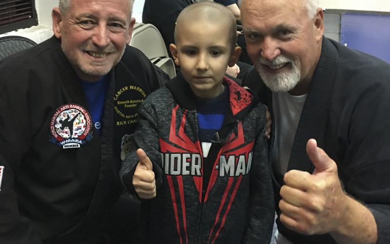 Image of Aiden Wallace, center, was awarded an honorary black belt.