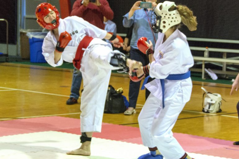 Image Showing Two Girls In Action During A Training Session.