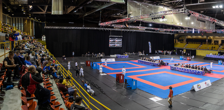 Karate Event On A Stadium - Multi Number Of Sport Athletes Getting Prepared For The Competition.