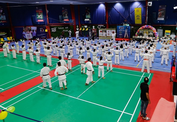 Mass Number Of Karate Athelets Practicing In The Stadium.