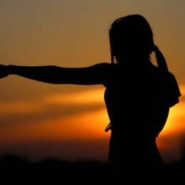 A Silhouette Of Young Woman On Her Martial Art Training In The Early Morning.
