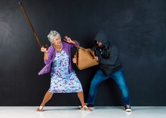 Robber Trying To Snatching A Bag From A Senior Woman.