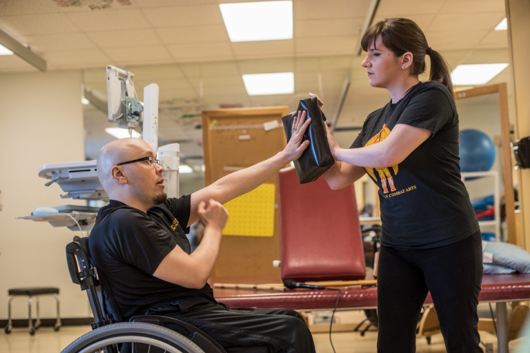 A Wheelchair User Trying To Defend His Trainer.