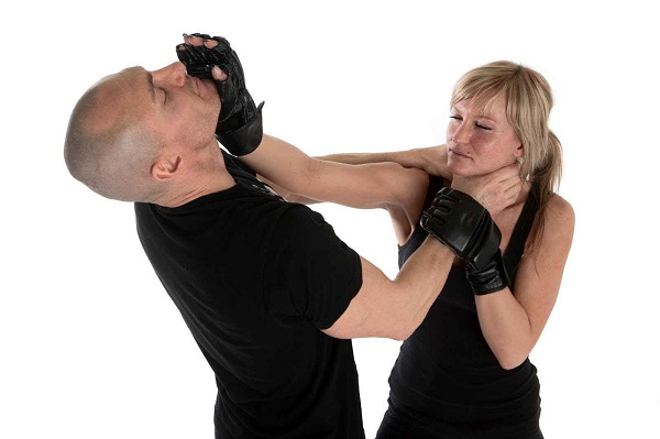 Woman Self Defense Training With Her Trainer.