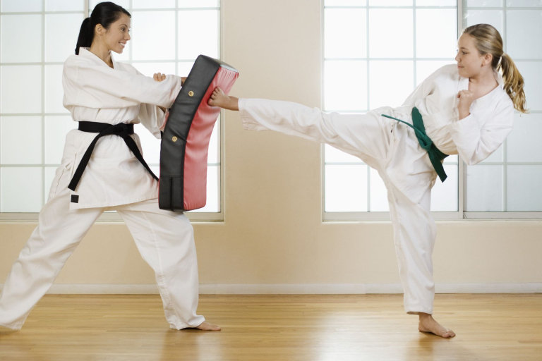Two Woman In Their Martial Arts Training.