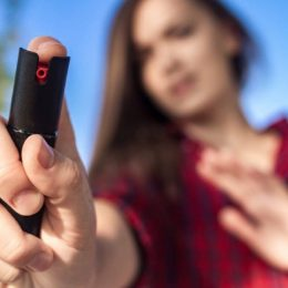 A Young Girl Holding Her Pepper Spray For Self Defense.