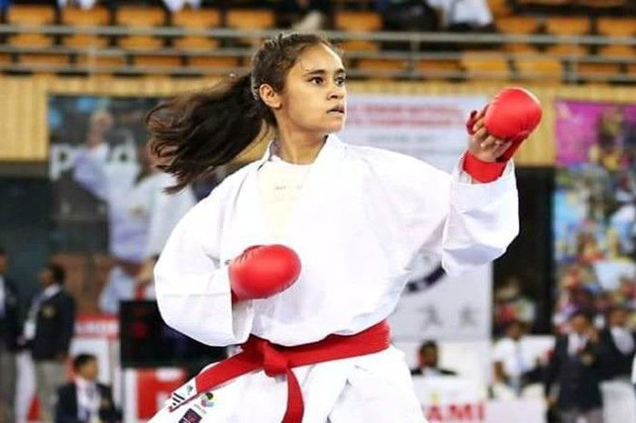 A Young Woman In An Action On A Karate Tournament.