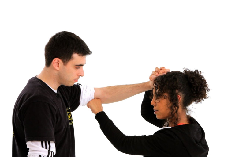 A Woman Defending A Man Pulling Her Hair.