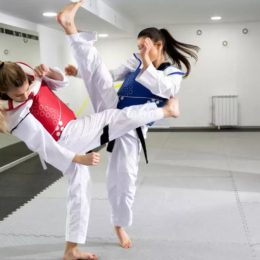 Two Female Karate Trainers In Action.