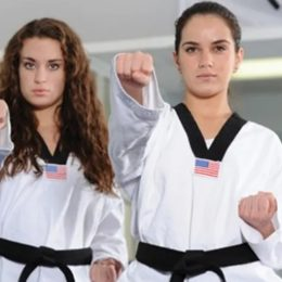 Two Female Fighters Punching At The Camera.