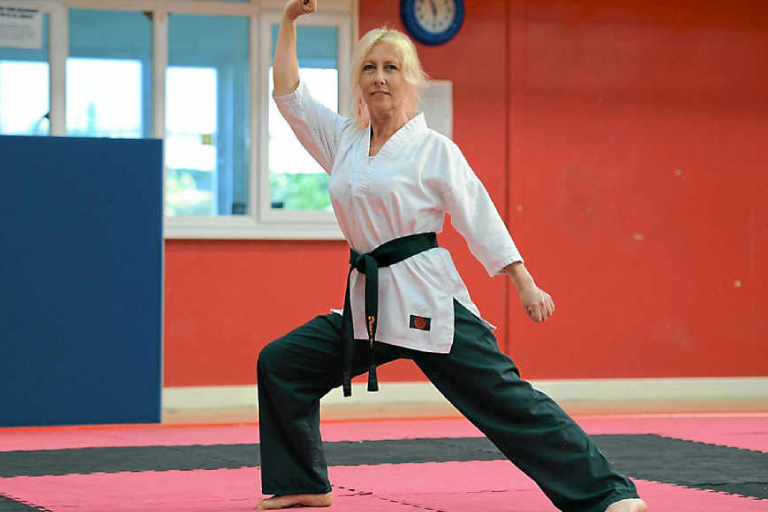 A Senior Female Martial Art Fighter In Her Training Session.